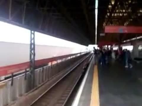 Woman Almost Gets Hit by Train Retrieving Her Phone