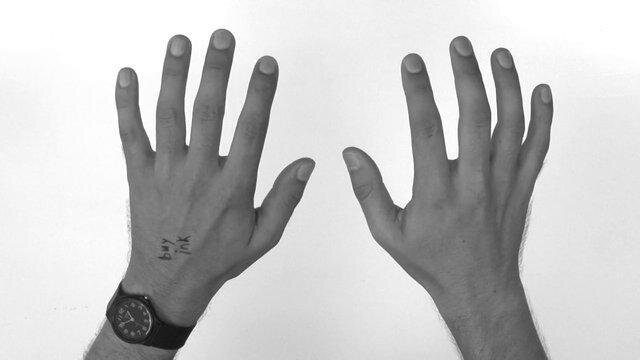 Mind-Boggling Video Repeatedly Transitions Between Hands & Photos of Hands