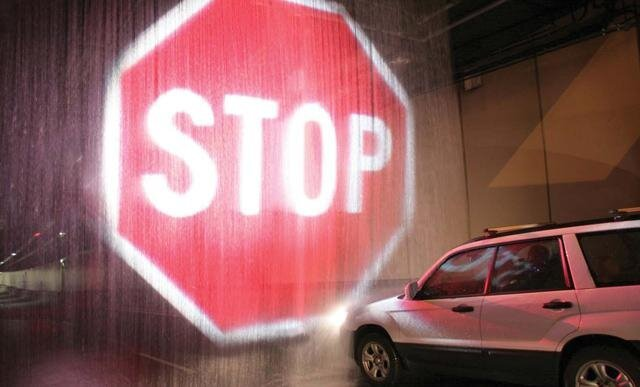 Incredibly Clever System Projects Giant Stop Sign on Water To Stop Cars in Emergency