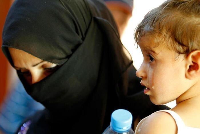 Всемирный день беженцев 2013 (16 фото)