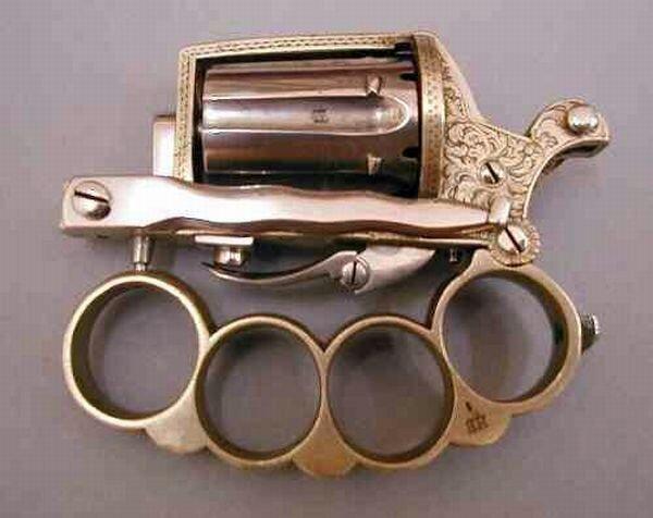 Пистолет, кастет и нож (5 фото)