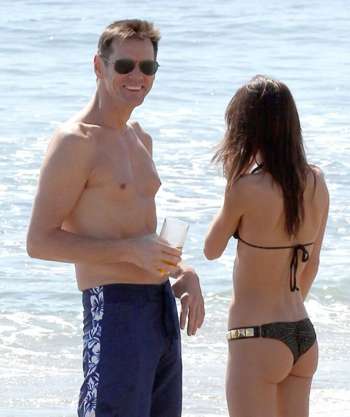 Jim Carrey Hits The Beach With A Lovely Lady