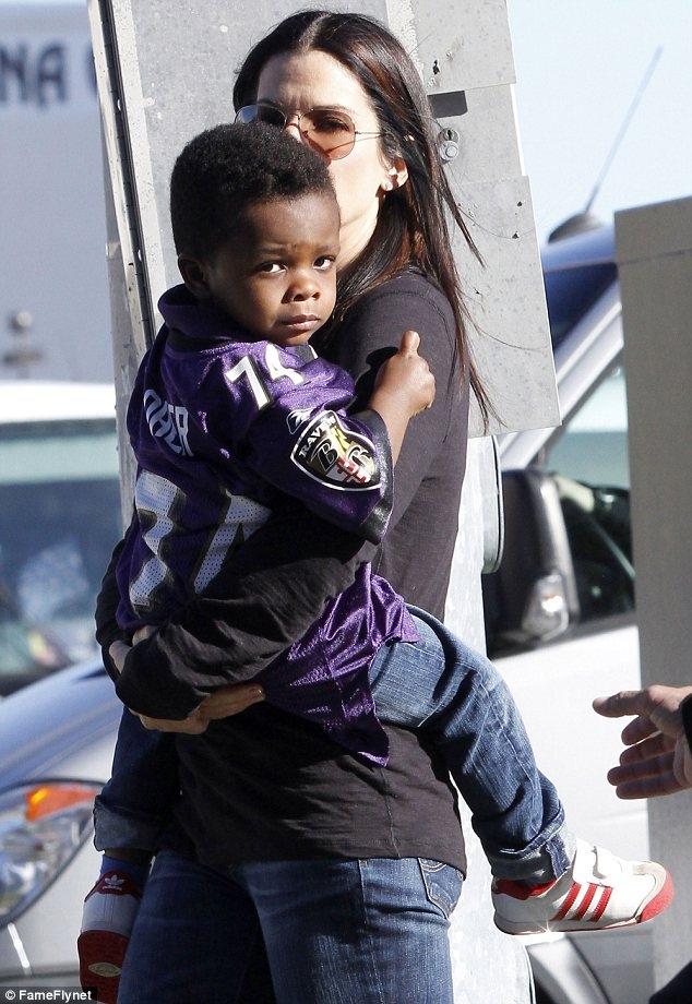 Sandra Bullock's son Louis sports Michael Oher jersey
