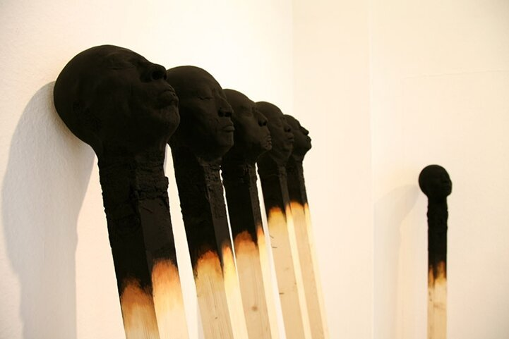 Giant Matchsticks Feature Eerie Human Faces