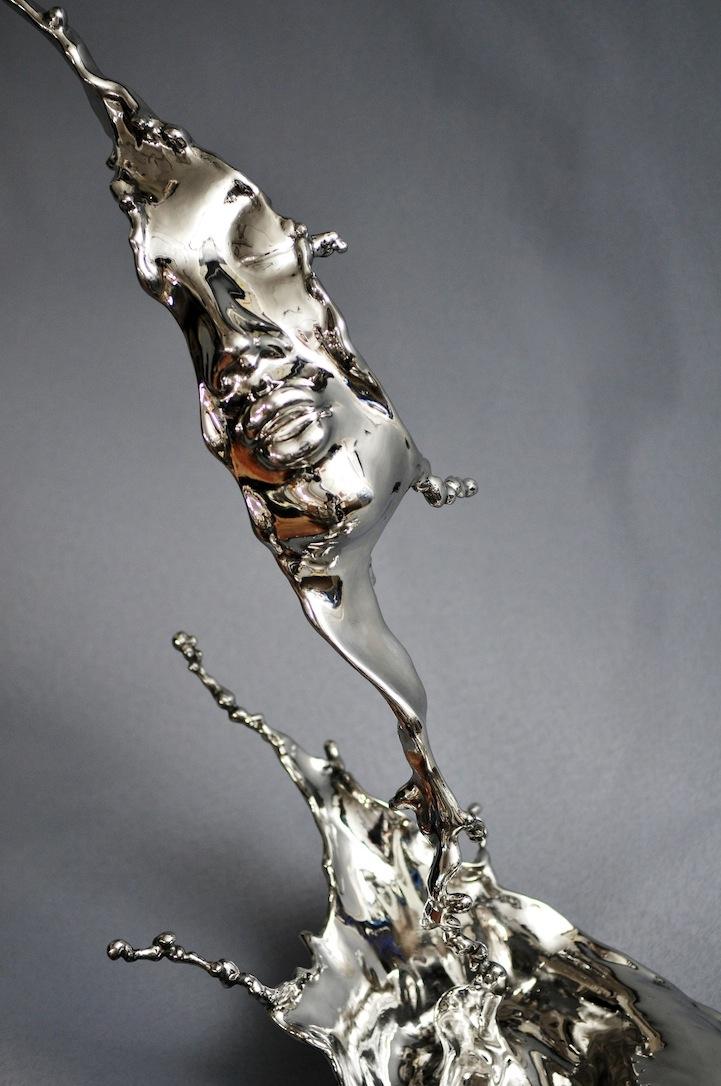 Surreal Sculptures of Human Faces Frozen in Liquid