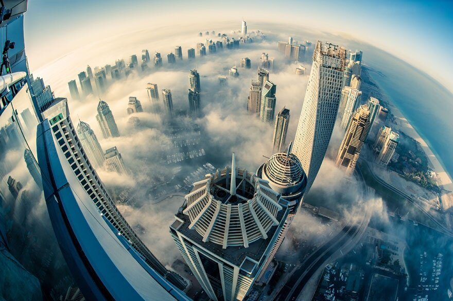 The City in the Clouds: Dubai Photographed from the 85th Floor By Sebastian Opitz