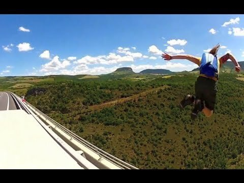 Base Jumper Leaps Off Bridge From a Moving Van!