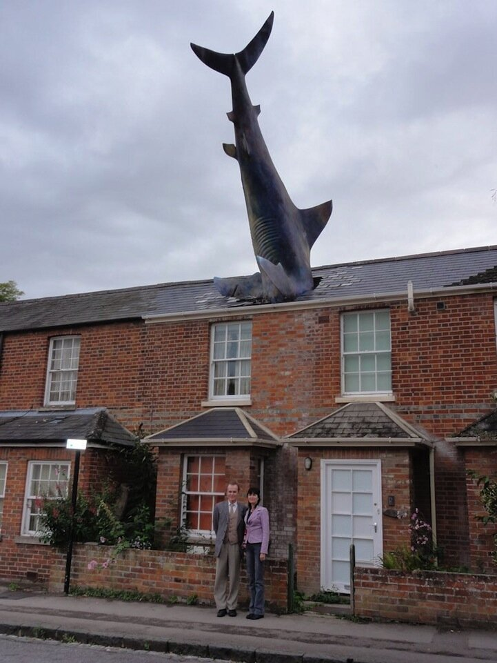 Surreal Shark Crashes Head-First Through a House
