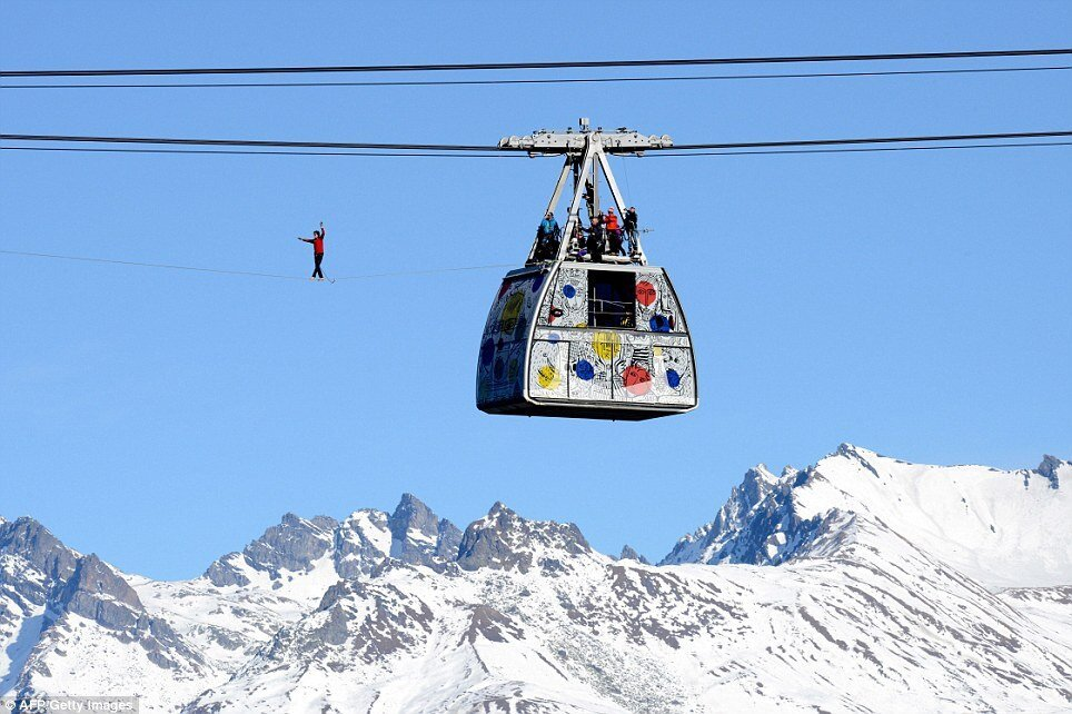 A daredevil highliner has performed a walk 1,200ft above the Alps.