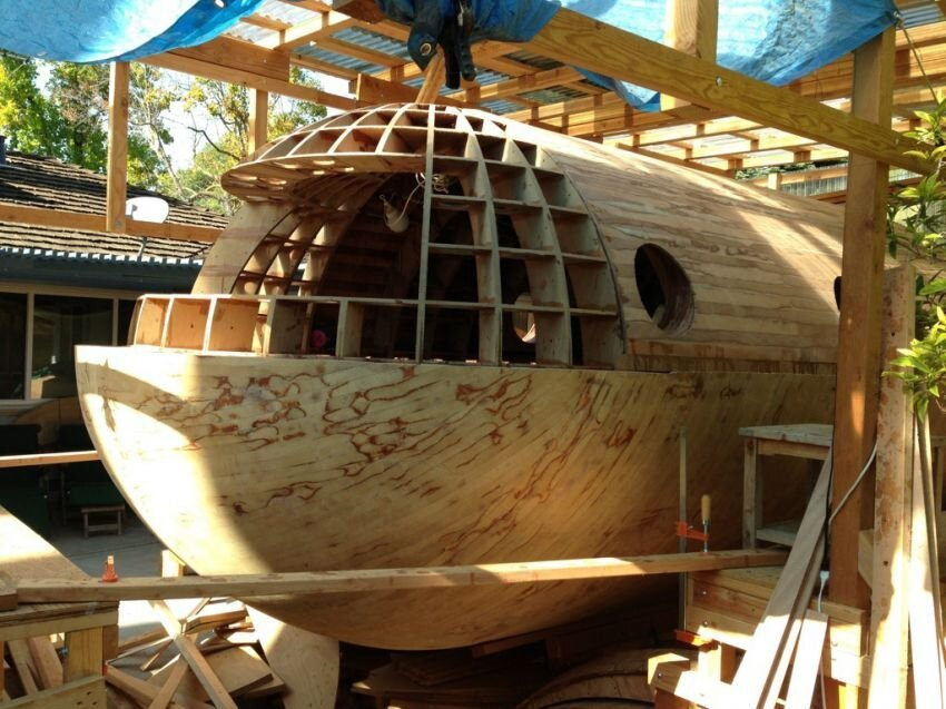 A designer  is constructing a boat that could be tsunami-proof