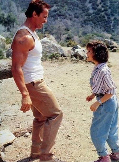 Arnold Schwarzenegger and Alyssa Milano Then & Now Read more at http:/