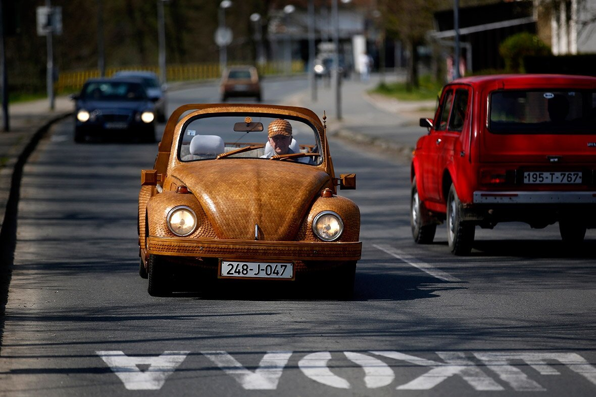 See That Guy In The Volkswagen Beetle? Well, Wait Til You Look Closer