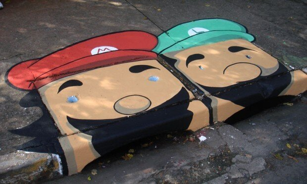 Two Artists Cover Gray Streets With Colorful Character Illustrations