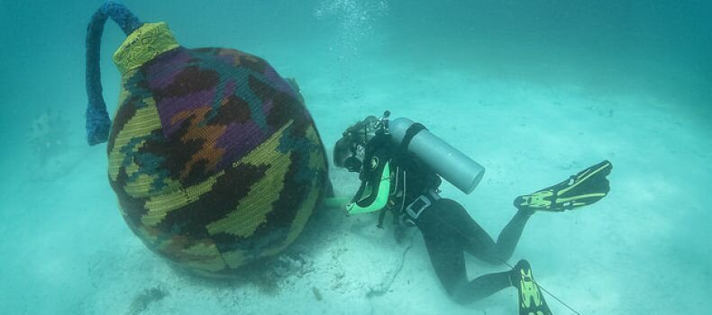 Artist Dives Underwater To Knit Cozy Sweaters For Submerged Objects