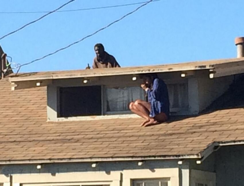 Woman Hides On Her Roof While Intruder Searches For Her