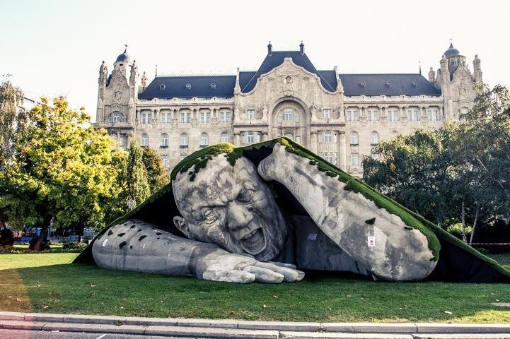 A Giant Sculpture Crawls Out Of The Ground In Budapest