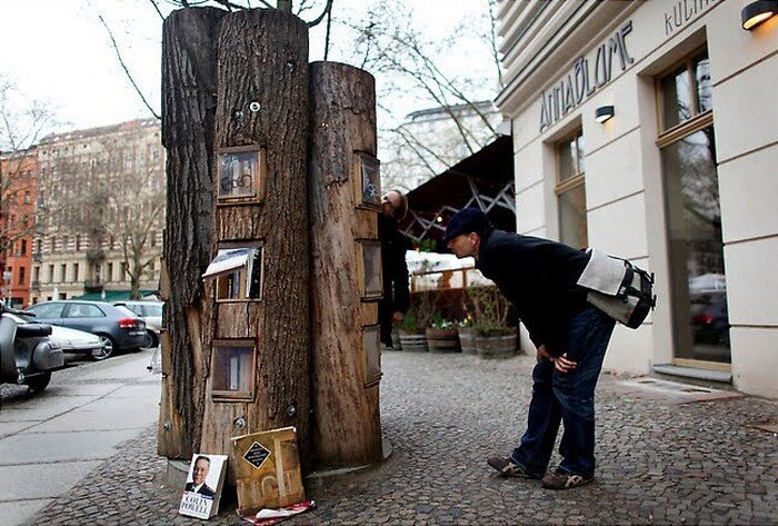 A Neighborhood In Germany Has A Book Exchange Inside Of Tree