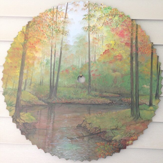 Most People Would Overlook An Old Saw Blade...But Not This Artist