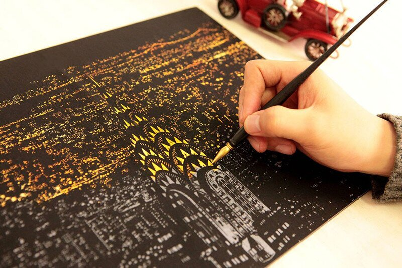 New Coloring Book Lets You Scratch Off Surface To Reveal Nightscrapes