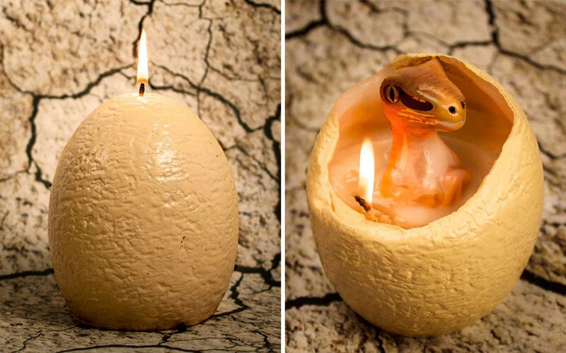 "Dinosaur Egg Candle That ""Hatches"" A Baby Raptor When It Melts"
