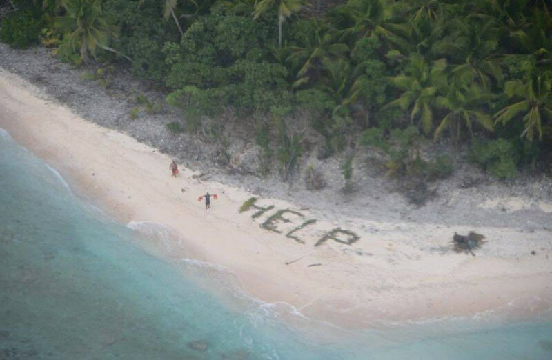 "These Guys Were Rescued From A Deserted Island By Writing ""HELP"" In The Sand"