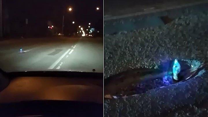 Неравнодушный ростовчанин пометил яму на дороге светящейся бутылкой
