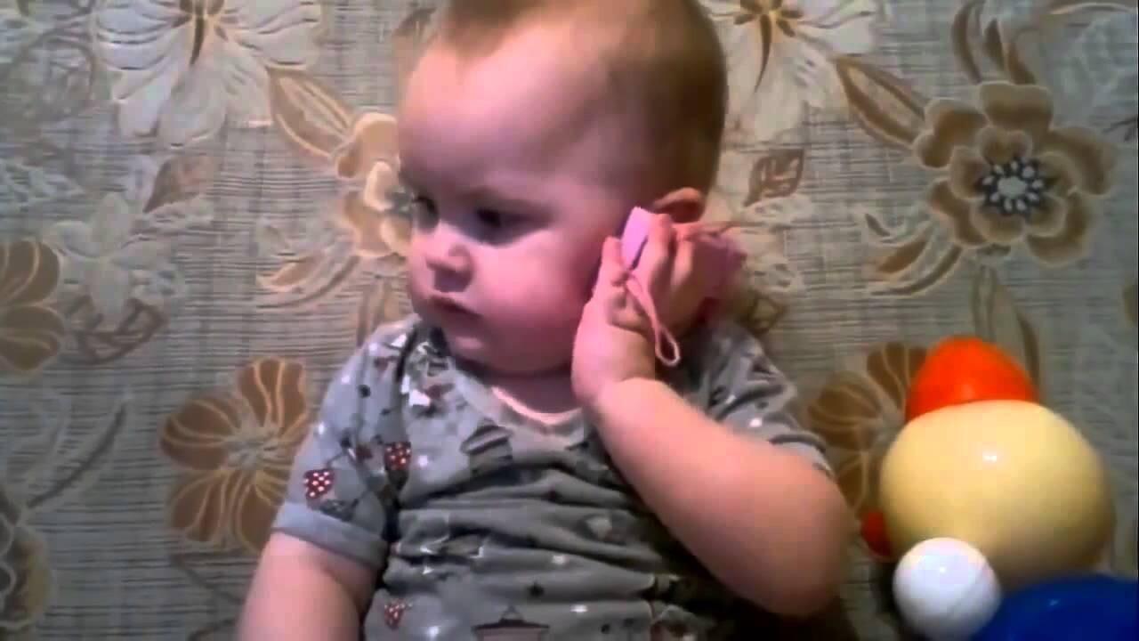 Важный разговор по телефону малыша