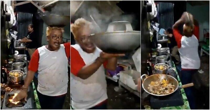 Малайзийский повар весело швыряется кастрюлями и кладет руку на огонь