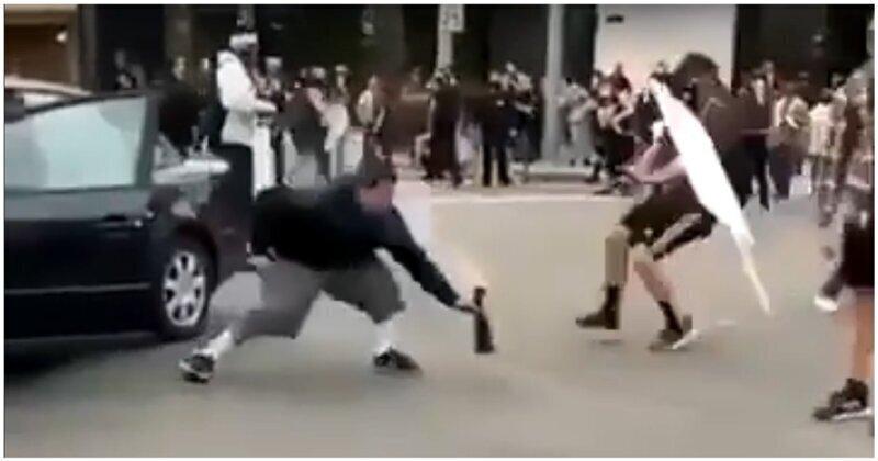 Неудачная попытка протестующего запустить фейерверк на оживленной улице