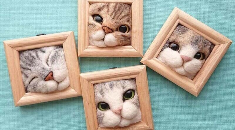 Японка создает забавные кошачьи мордочки, застрявшие в рамках