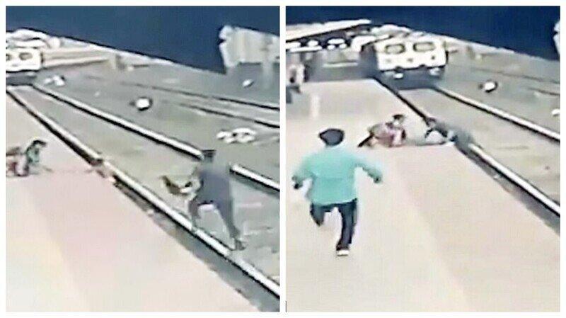 Видео: героическое спасение ребенка, упавшего на рельсы перед приближающимся поездом