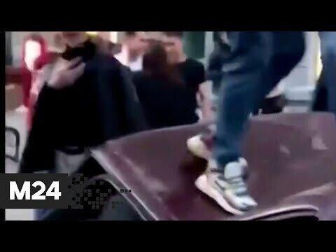 Люди танцующие на крыше машине лезгинку, проломили крышу