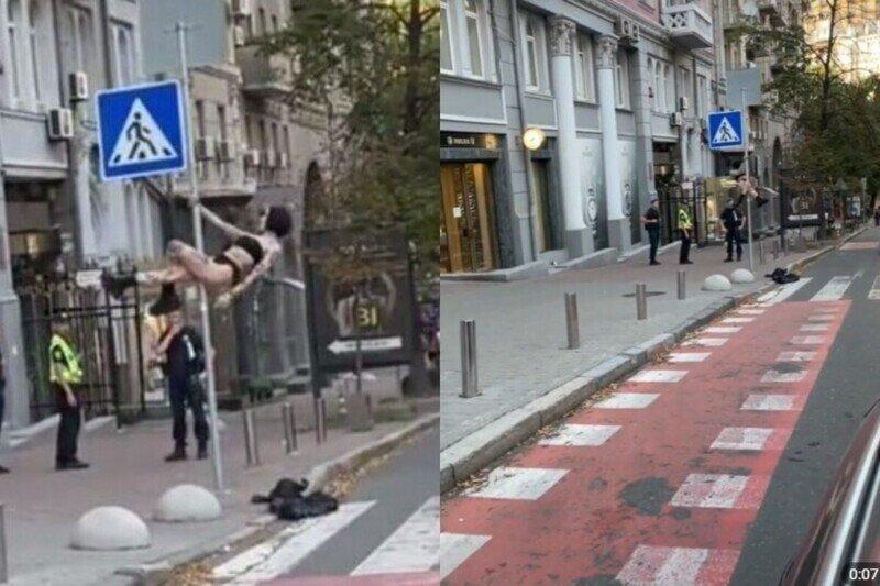 В Киеве девушка забралась на дорожный знак и станцевала для полицейских