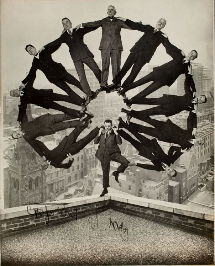 1. On the roof with eleven men in formation on their shoulders 1930