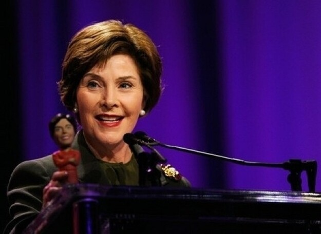 Laura Bush with a bobblehead of herself