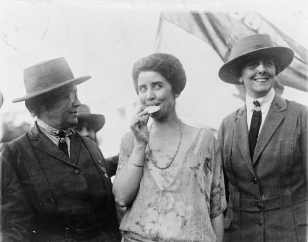 Grace Coolidge with a Girl Scout cookie