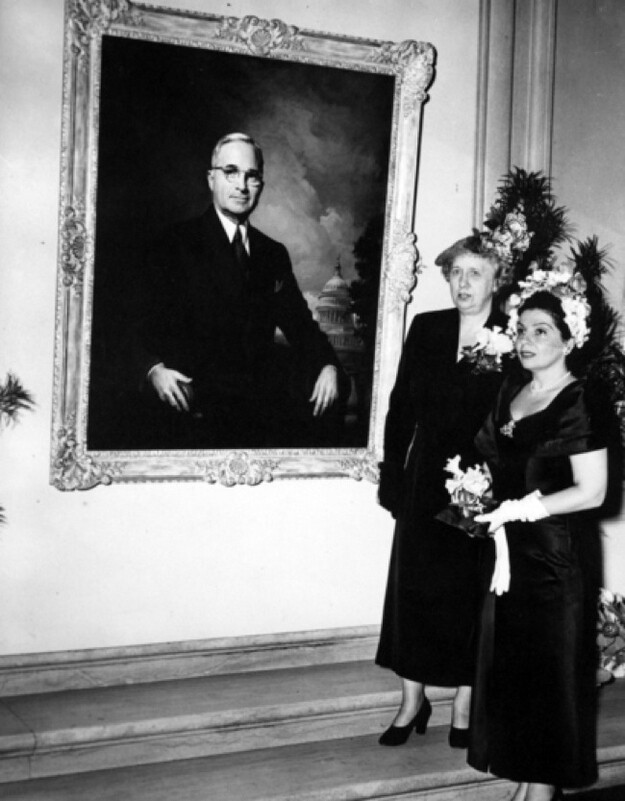 Bess Truman with a giant painting of Harry