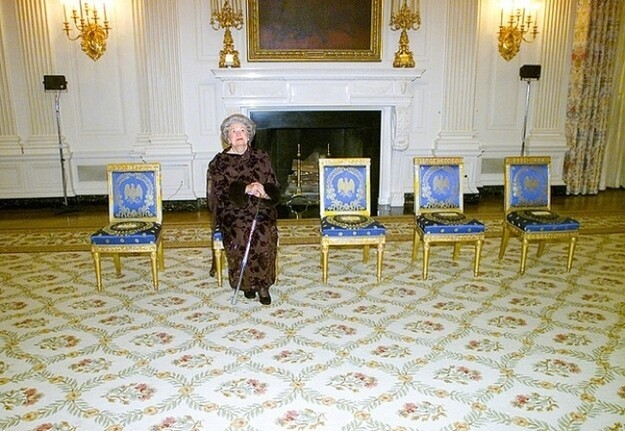 Lady Bird Johnson with 4 empty chairs