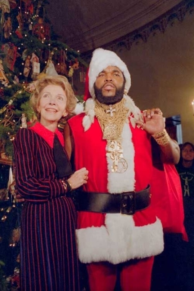 Nancy Reagan with Mr. T in a Santa suit