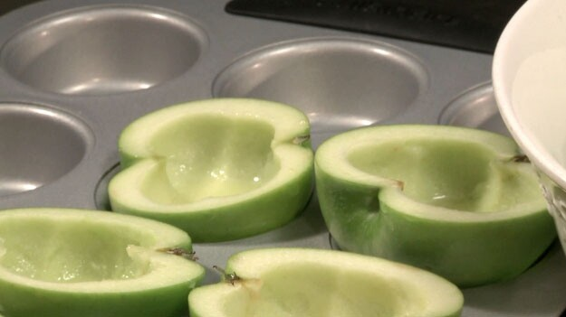 Set apple halves into cups of a muffin pan and admire how nice and snug they look.