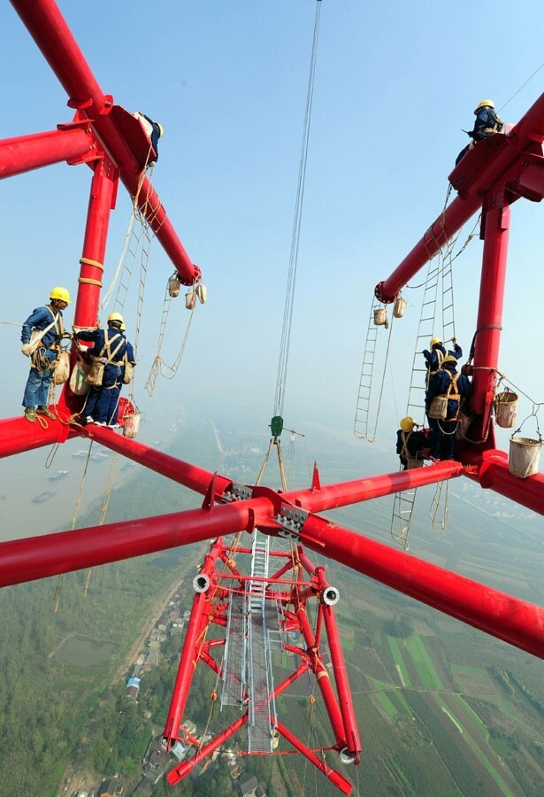 Workers on top of world's tallest pylon