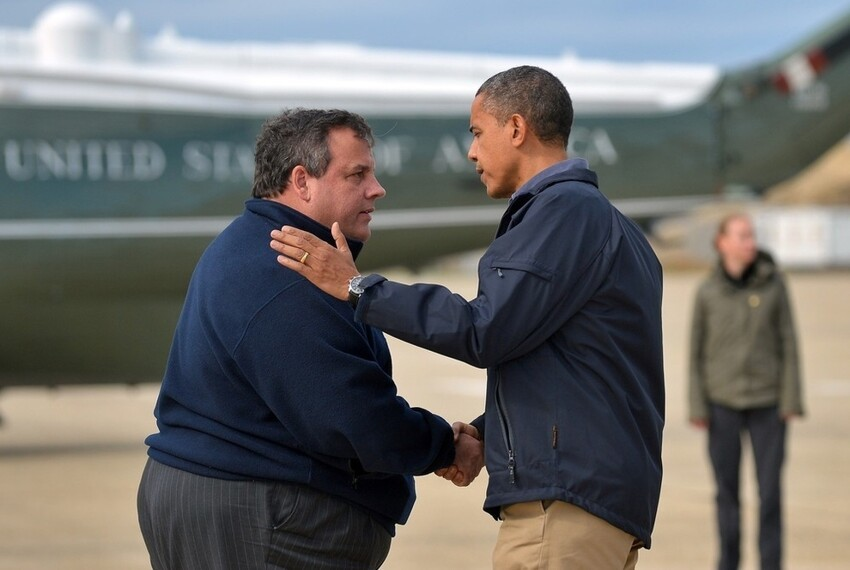 President Obama shakes hands with Governor Christie before touring storm damage.
