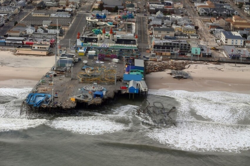 A view of storm damage in Seaside Heights from a helicopter traveling behind the helicopter carrying President Obama and