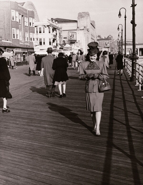 Woman dressed up on the boardwalk, 1940