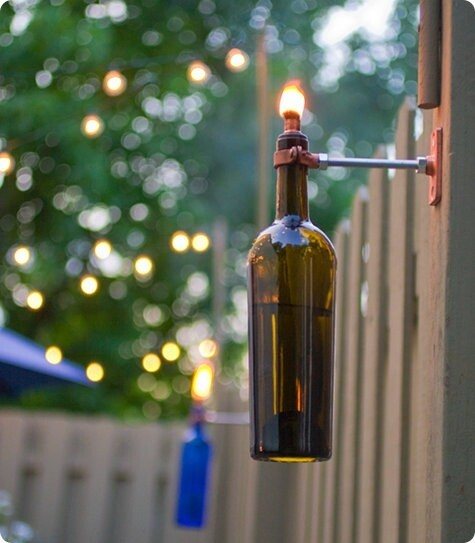 Turn an empty wine bottle into an outdoor sconce.