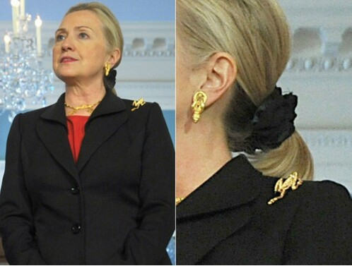 She wears frog jewelry... ON HER SHOULDER.