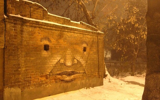 Russian Graffiti Artist Turns Buildings Into Giant Characters