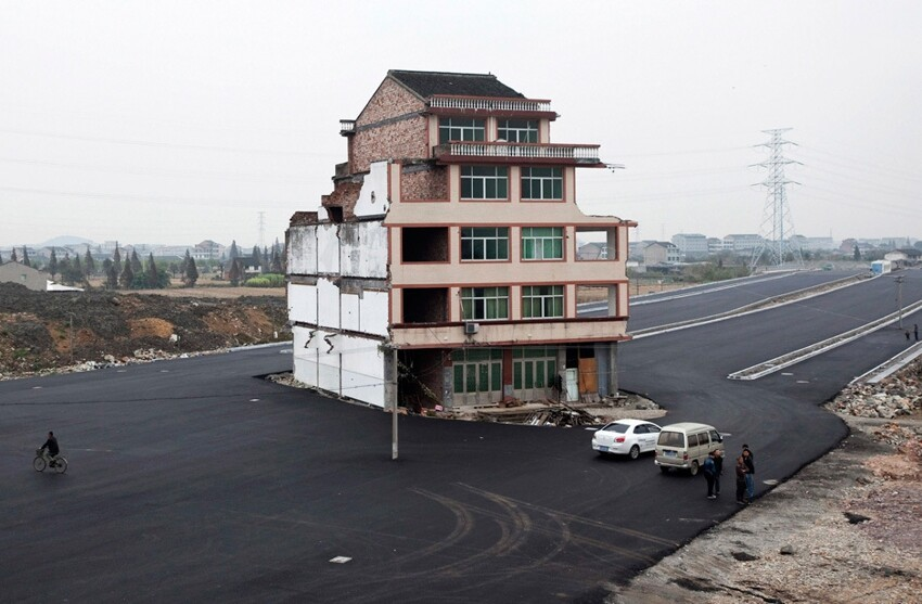 Homeowners don't give up. China builds highway anyways.