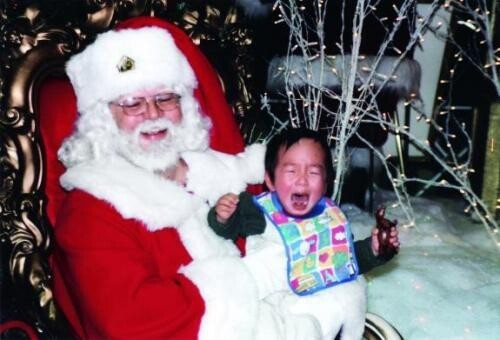 Festive Photos Of Santa Terrifying Children