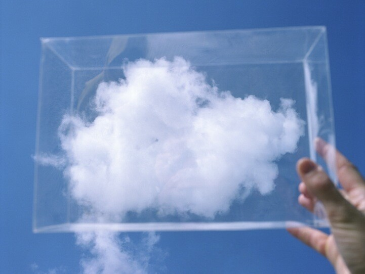Photographer Captures Fluffy Clouds in Glass Boxes